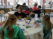 Students paint on canvas during 2015 YWAC session.