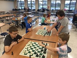 Students playing chess at the 2017 fall tournament.