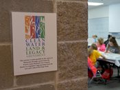 Clean water land and legacy grant sign outside student session.