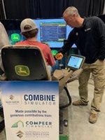 Student on combine simulator