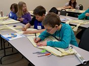 Students decorate Native American Ojibwe bags during 2015 YWAC session.