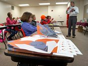Students practice folding paper with Professor Origami at 2015 YWAC