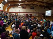 The BLC gym is filled with students and chaperones for the 2015 YWAC keynote presentation