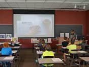 2015 YWAC presenter illustrates for on screen students as they follow along.