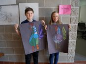 "Students hold up their artwork from ""The Rooster"" session."