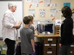 Sletta, two students and Ehlers try out the new 3D printer.