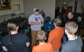 Students are briefed on the skills necessary to work for a manufacturing company.